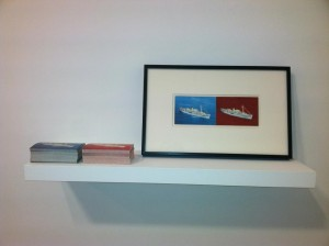 Red C/Red Sea, 2013  Postcard and paint on postcard on museum board: Printed postcards on wood shelf.